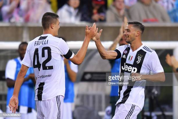 Andrea Favilli of Juventus is congratulated by teammate Mattia De Sciglio after scoring a goal during the game against Bayern Munich during the...