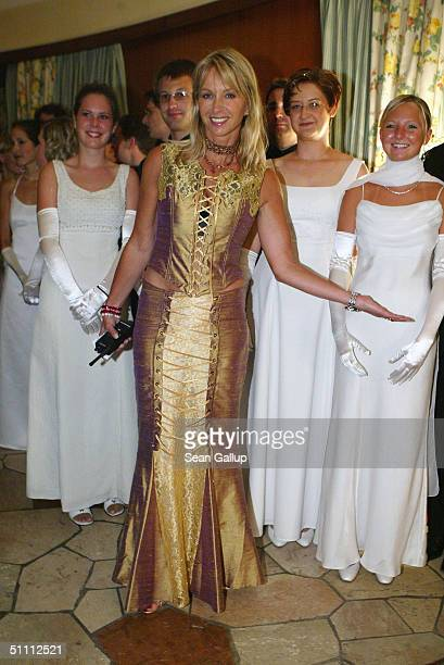 Andrea Fendrich and debutantes arrive at the 'Summer Night Ball' at Hellbrunn Palace July 24 2004 in Salzburg Austria