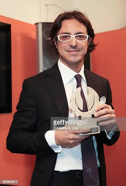 Andrea Ferrari shows his award during the '2009 Margutta Awards' at Margutta RistorArte on November 24 2009 in Rome Italy
