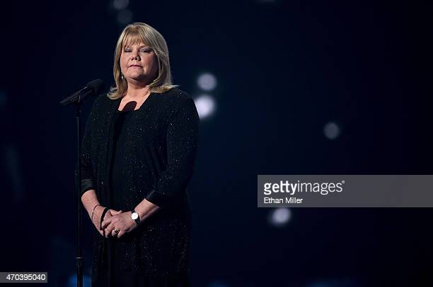 Andrea Finlay speaks onstage during the 50th Academy of Country Music Awards at ATT Stadium on April 19 2015 in Arlington Texas