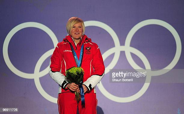 Andrea Fischbacher of Austria receives the gold medal during the medal ceremony for the women's superg alpine skiing held at the Whistler Medals...