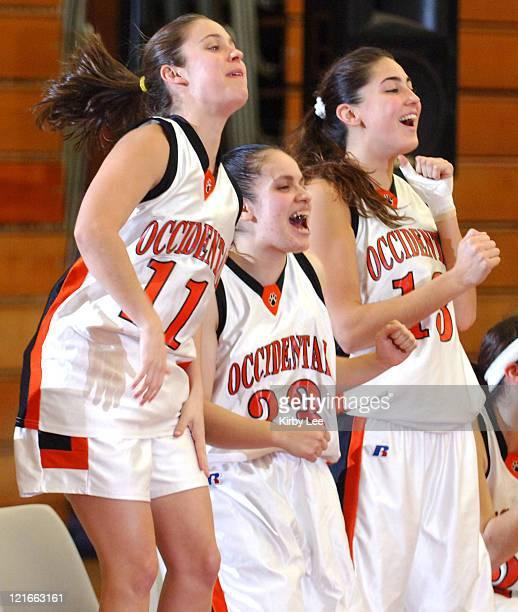 Andrea Freeman , Anahit Aladzhanyan and Ayesha Khan of Occidental celebrate during the nonconference women's basketball game between Nebraska...