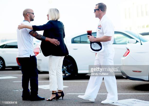 ANdrea Gallagher hugs a well wisher before she and her husband Navy Special Operations Chief Edward Gallagher walk into military court on Tuesday...