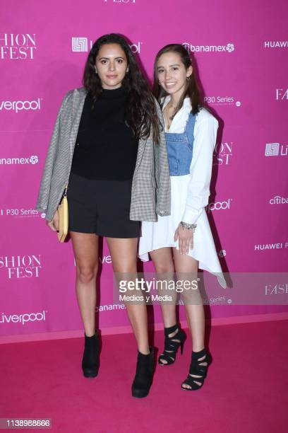Andrea Garcia and Amaya Pereda poses for photos during the Pink Carpet as part of the Spring/ Summer Liverpool Fashion Fest 2019 on March 28 2019 in...