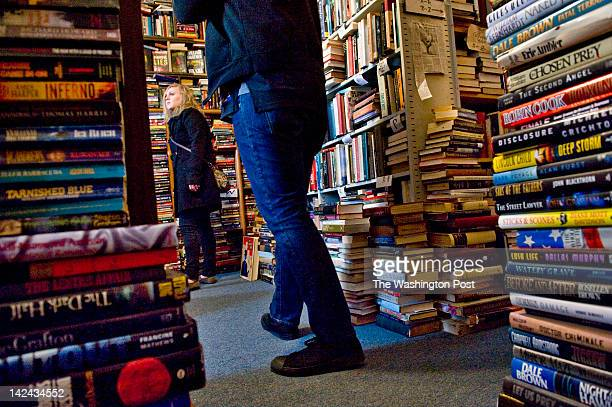 Andrea Georgic of Elizabethtown, PA, and Matthew Salyers of Fairfax peruse the selection of books at Capitol Hill Books on Sunday, February 6, 2011...