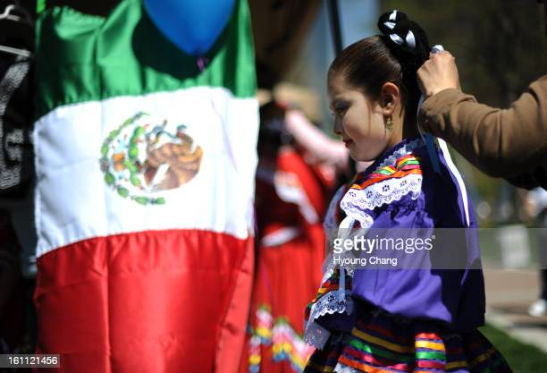 Andrea Gomez a dancer from Roots of Mexico is preparing for the dance in 22nd Cinco de Mayo festival in downtown Denver on Saturday The Hyoung Chang/...