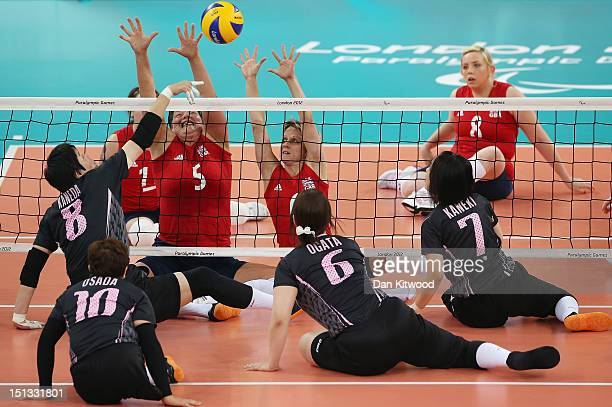 Andrea Green and Emma Wiggs of Great Britain reach up to block a shot during the Women's Sitting Volleyball 78 Clasification match against Japan on...