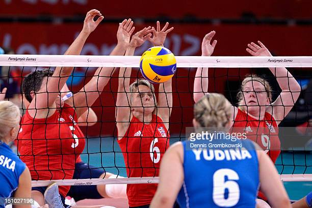 Andrea Green of Great Britain and teammates Emma Wiggs and Nicole Hill block during the Women's Sitting Volleyball Preliminaries Pool A match between...