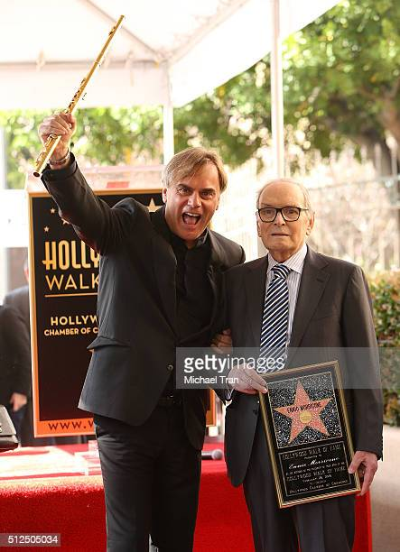 Andrea Griminelli and Ennio Morricone attend the ceremony honoring Ennio Morricone with a Star on The Hollywood Walk of Fame held on February 26 2016...