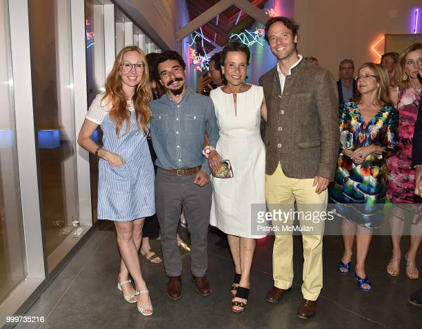 Andrea Grover Rafael Alonso Christina MacDonald and Alex MacDonald attend the Parrish Art Museum Midsummer Party 2018 at Parrish Art Museum on July...