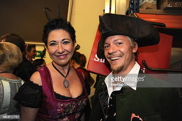 Andrea Haendler and Christoph von Friedl pose backstage during the Pro Juventute Charity Fashion Show at Studio 44 on April 27 2015 in Vienna Austria