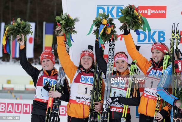 Andrea Henkel Laura Dahlmeier Evi SachenbacherStehle and Franziska Preuss of Germany celebrate second place after the women's 4x6km relay on day one...