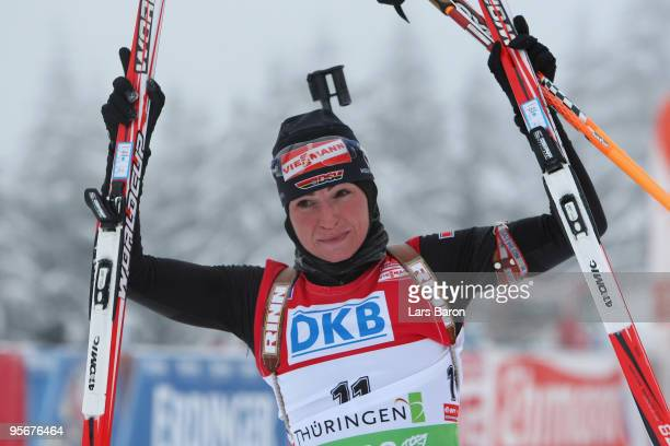 Andrea Henkel of Germany celebrates after winning the Women's 12,5 km mass start in the e.on Ruhrgas IBU Biathlon World Cup on January 10, 2010 in...