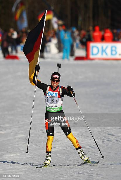 Andrea Henkel of Germany celebrates winning the gold medal in the Women's 4 x 6km Relay during the IBU Biathlon World Championships at Chiemgau Arena...