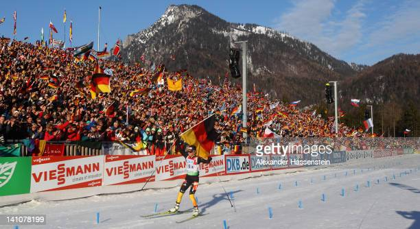 Andrea Henkel of Germany celebrates winning the Women's 4 x 6km Relay during the IBU Biathlon World Championships at Chiemgau Arena on March 10, 2012...