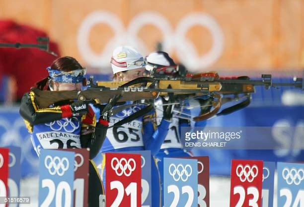 Andrea Henkel of Germany Magdalena Forsberg of Sweden and Zdenka Vejnarova of the Czech Republic shoot during the Womens 15 km Individual Biathlon 11...