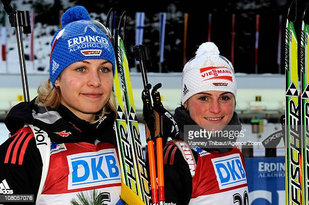 Andrea Henkel of Germany takes 2nd place Magdalena Neuner of Germany takes 3rd place during the IBU World Cup Biathlon Women's 75 km Sprint on...