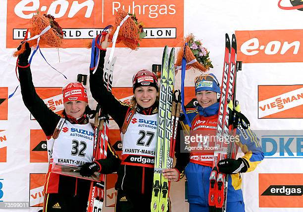 Andrea Henkel of Germany takes 2nd place Magdalena Neuner of Germany takes 1st place and Anna Carin Olofsson of Sweden takes 3rd place during the IBU...
