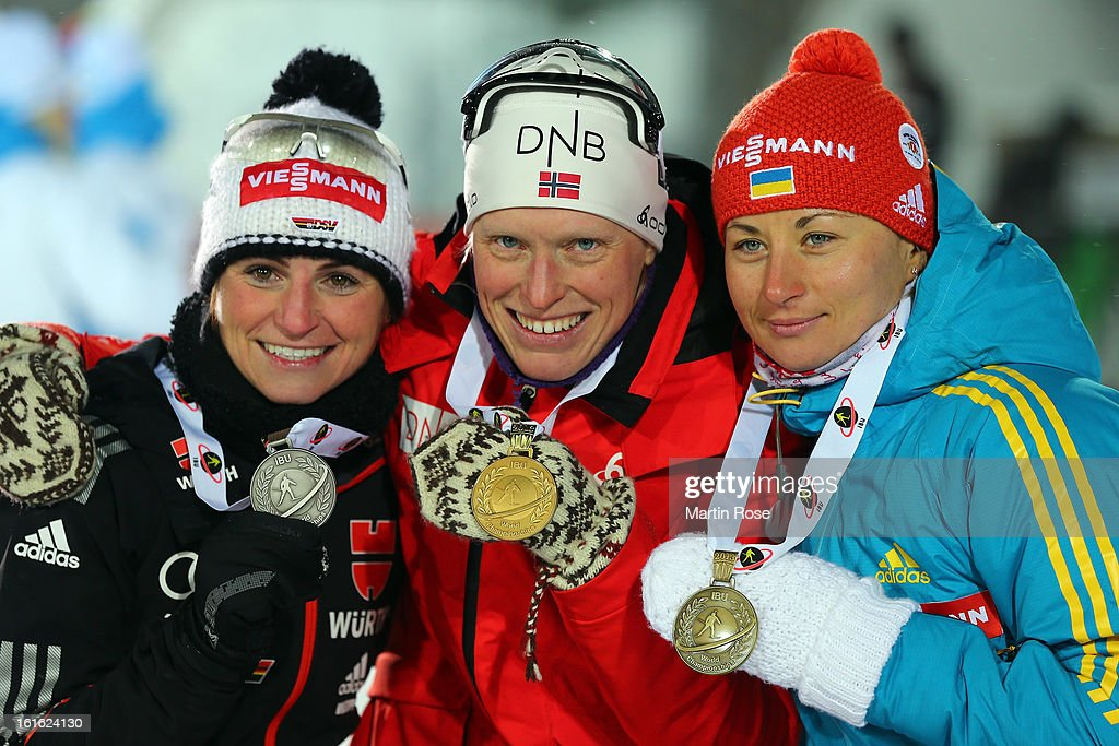 Andrea Henkel of Germany (silver), Tora Berger of Norway (gold) and Valj Semerenko of Ukraine (bronze) celebrate after the Women's 15km Individual during the IBU Biathlon World Championships at Vysocina Arena on February 13, 2013 in Nove Mesto na Morave, Czech Republic.
