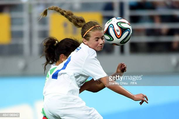 Andrea Herbrikova of Slovakia heads the ball during the 2014 FIFA Girls Summer Youth Olympic Football Tournament 3rd Place Playoff match between...