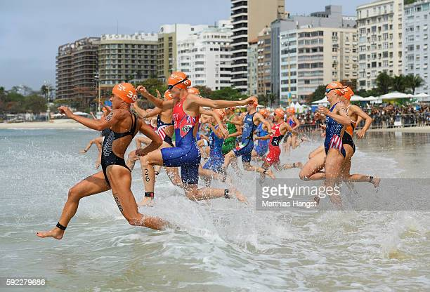 Andrea Hewitt of New Zealand Flora Duffy of Bermuda and Katie Zaferes of the United States compete during the Women's Triathlon on Day 15 of the Rio...