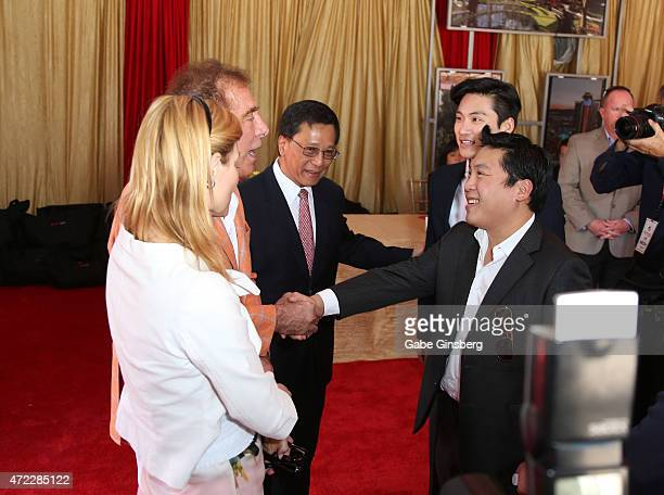 Andrea Hissom and her husband Wynn Resorts Chairman CEO Steve Wynn are greeted by Chairman and CEO of the Genting Group KT Lim Lim Keong Loui and Hui...