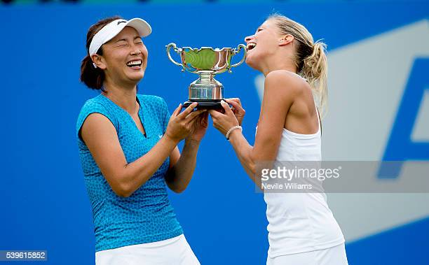 Andrea Hlavackova of Czech Republic and Shuai Peng of China with the Doubles winners trophy on day seven of the WTA Aegon Open on June 12 2016 in...