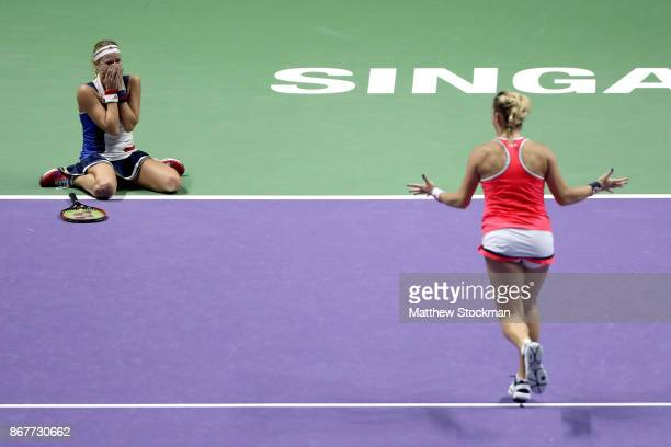 Andrea Hlavackova of Czech Republic and Timea Babos of Hungary celebrate victory in the Doubles Final against Johanna Larsson of Sweden and Kiki...