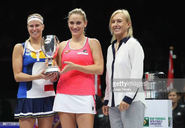 Andrea Hlavackova of Czech Republic and Timea Babos of Hungary pose with the Martina Navratilova trophy after victory in the Doubles Final against...