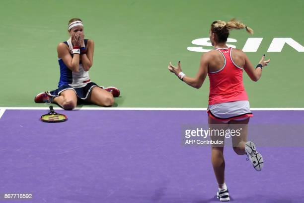 Andrea Hlavackova of Czech Republic and Timea Babos of Hungary celebrate winning the women's doubles final against Kiki Bertens of Netherlands and...