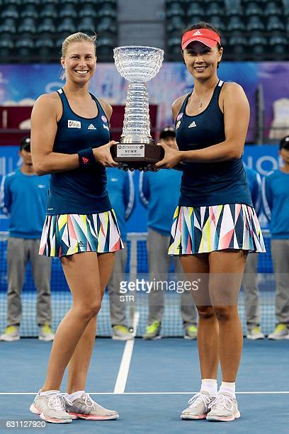 Andrea Hlavackova of the Czech Republic and Peng Shuai of China pose with their trophy after winning the women's final match against Raluca Olaru of...