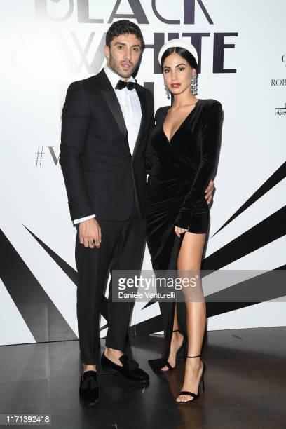 Andrea Iannone and Giulia De Lellis attend the Vanity Fair Black And White Ball Photocall during the 76th Venice Film Festival at Scuola Grande della...
