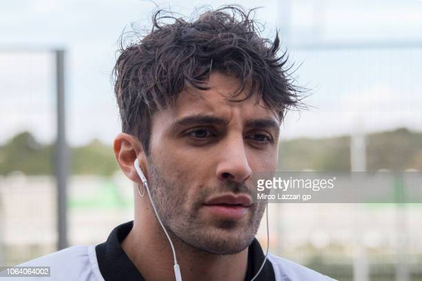 Andrea Iannone of Italy and Aprilia Racing Team Gresini looks on in pit during the MotoGP Tests In Valencia at Ricardo Tormo Circuit on November 21...