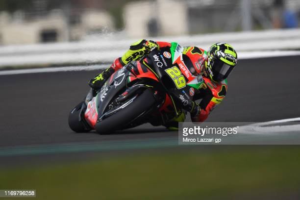 Andrea Iannone of Italy and Aprilia Racing Team Gresini rounds the bend during the MotoGp Of Great Britain Free Practice at Silverstone Circuit on...