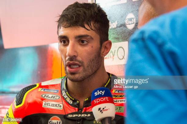 Andrea Iannone of Italy and Aprilia Racing Team Gresini speaks with journalists during the MotoGp of Austria Free Practice at Red Bull Ring on August...