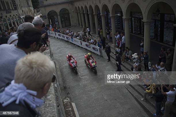 Andrea Iannone of Italy and Ducati Team and Andrea Dovizioso of Italy and Ducati Team ride the bikes during the preevent 'MotoGP bikes thru the...
