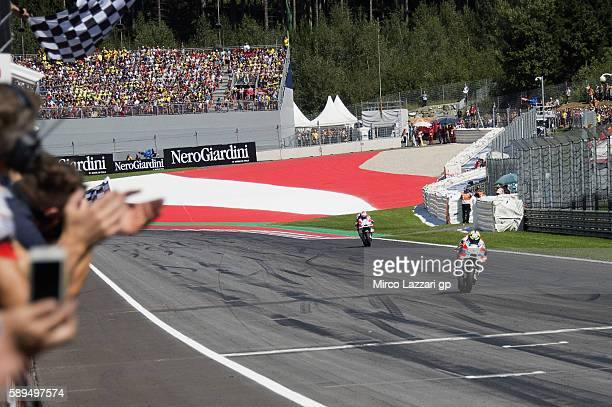Andrea Iannone of Italy and Ducati Team cuts the finish lane and celebrates the victory at the end of the MotoGp race during the MotoGp of Austria...