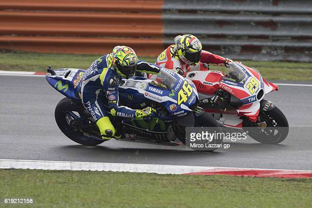Andrea Iannone of Italy and Ducati Team leads Valentino Rossi of Italy and Movistar Yamaha MotoGP during the MotoGP race during the MotoGP Of...