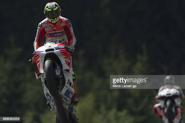 Andrea Iannone of Italy and Ducati Team lifts the front wheel during the MotoGp of Austria Qualifying at Red Bull Ring on August 13 2016 in Spielberg...
