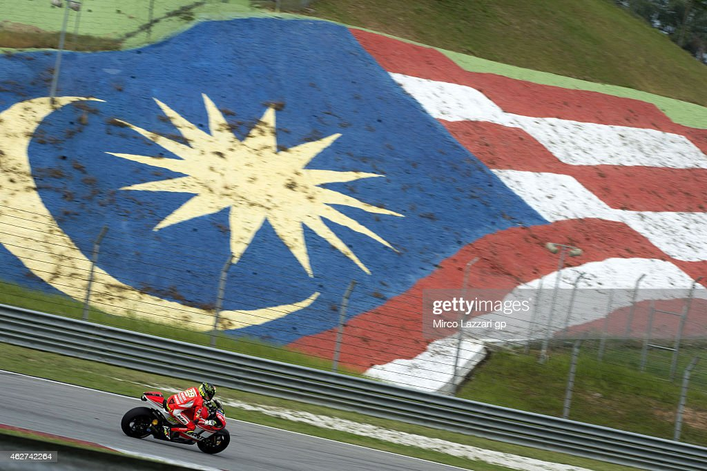 Andrea Iannone of Italy and Ducati Team rounds the bend during day one of the MotoGP tests at Sepang Circuit on February 4, 2015 in Kuala Lumpur, Malaysia.