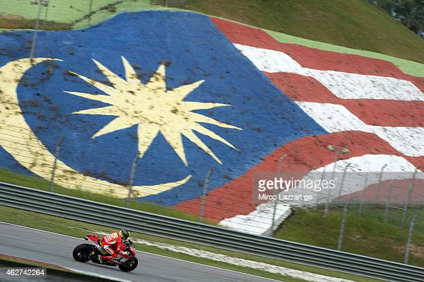 Andrea Iannone of Italy and Ducati Team rounds the bend during day one of the MotoGP tests at Sepang Circuit on February 4 2015 in Kuala Lumpur...