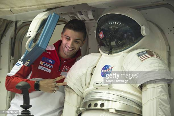 Andrea Iannone of Italy and Ducati Team smiles near spacesuit during the preevent 'MotoGP Riders Visit The NASA Johnson Space Center' at Lyndon B...