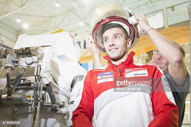 Andrea Iannone of Italy and Ducati Team tests a space helmet during the preevent 'MotoGP Riders Visit The NASA Johnson Space Center' at Lyndon B...