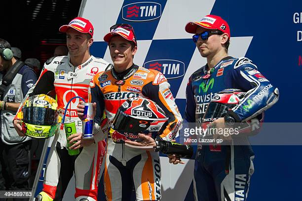 Andrea Iannone of Italy and Pramac Racing Marc Marquez of Spain and Repsol Honda Team and Jorge Lorenzo of Spain and Movistar Yamaha MotoGP pose at...