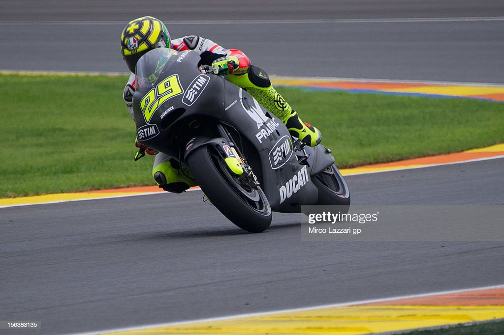 Andrea Iannone of Italy and Pramac Racing Team rounds the bend during the second day of pre season MotoGP testing at Ricardo Tormo Circuit on November 14, 2012 in Valencia, Spain.