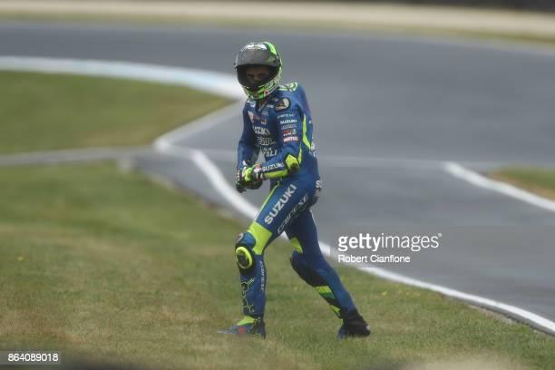 Andrea Iannone of Italy and rider of the TEAM SUZUKI ECSTAR Suzuki crashes during free parctice for the 2017 MotoGP of Australia at Phillip Island...