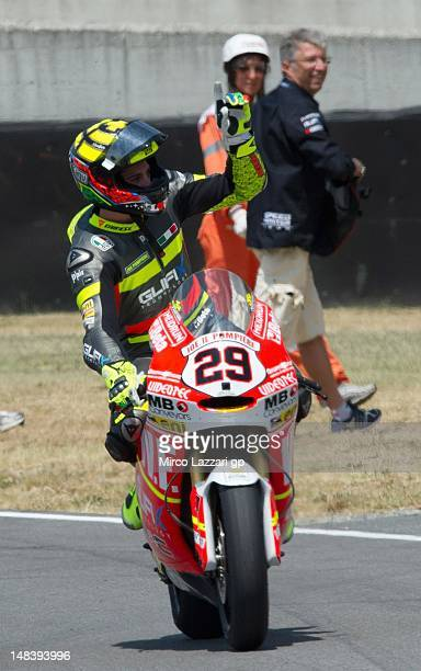 Andrea Iannone of Italy and Speed Master acknowleges fans after the Moto2 race of the MotoGP of Italy at Mugello Circuit on July 15 2012 in Scarperia...
