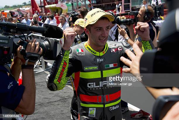 Andrea Iannone of Italy and Speed Master celebrates victory after the Moto2 race of the MotoGP of Italy at Mugello Circuit on July 15 2012 in...