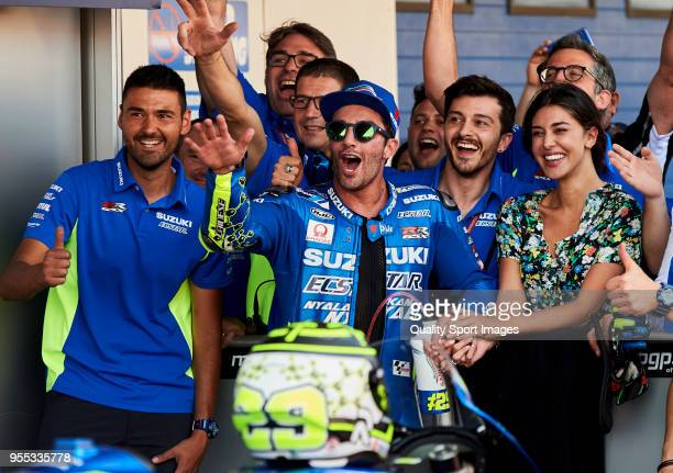 Andrea Iannone of Italy and Team Suzuki Ecstar celebrates third places with his team at Circuito de Jerez Angel Nieto on May 6 2018 in Jerez de la...