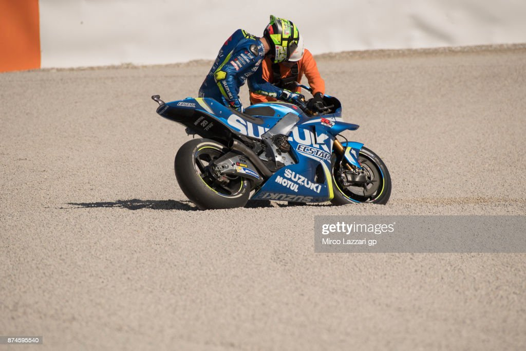 Andrea Iannone of Italy and Team Suzuki ECSTAR checks the bike after crashed out during the MotoGP Tests In Valencia day 2 at Comunitat Valenciana Ricardo Tormo Circuit on November 15, 2017 in Valencia, Spain.